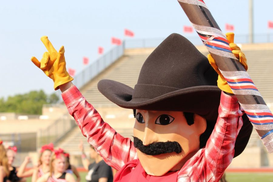 Cowboy Carl hypes up Coppell High School students at the pep rally at Buddy Echols Field on Sept. 13. Cowboy Carl is a staple mascot at CHS events. Photo by Angelina Liu