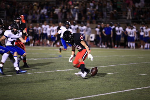 Coppell sophomore wide receiver Luca Grolosi muffs a punt return against Hebron at Buddy Echols Field last night. The Cowboys fell to the Hawks, 34-12.