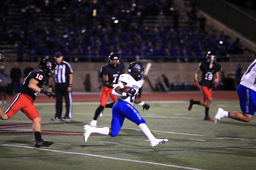 Coppell senior linebacker Cooper Seidman chases Hebron junior running back Fred Ware last night at Buddy Echols Field on Friday. The Cowboys fell to the Hawks, 34-12.