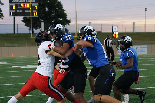 Coppell senior defensive back Miles Hardy tackles Plano West senior wide receiver Cristian Baul at John Clark Stadium on Oct.1. The Cowboys travel to Marauder Stadium to play Marcus tomorrow at 7 p.m.